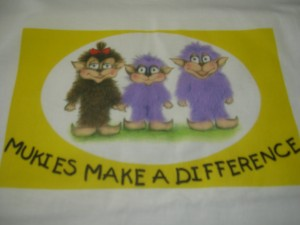 Mukies shirt1 300x225 Finding Happiness in Your Own Back Yard